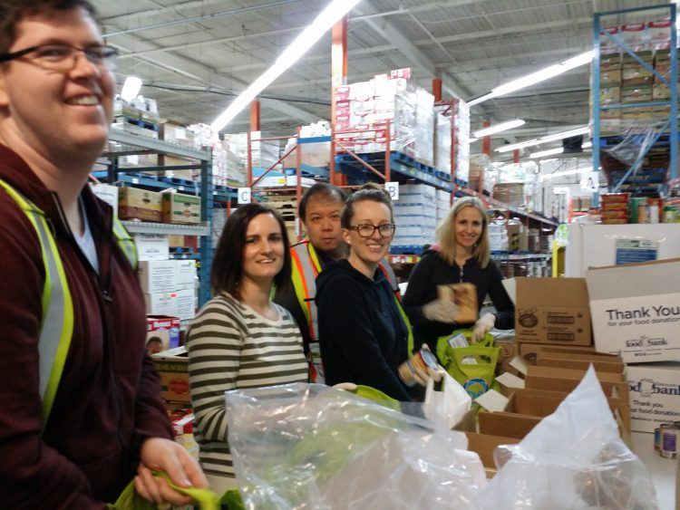Packing supplies at the Vancouver Food Bank